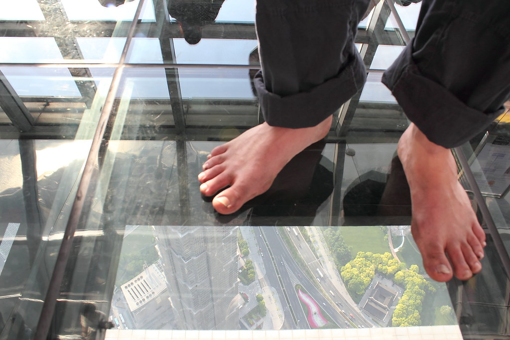 A view through the glass floor on the observation deck of for Glass deck floor
