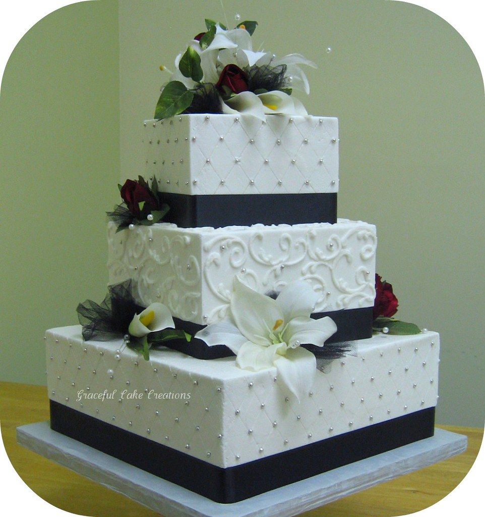Black Wedding Cake With Royal Blue Decorations