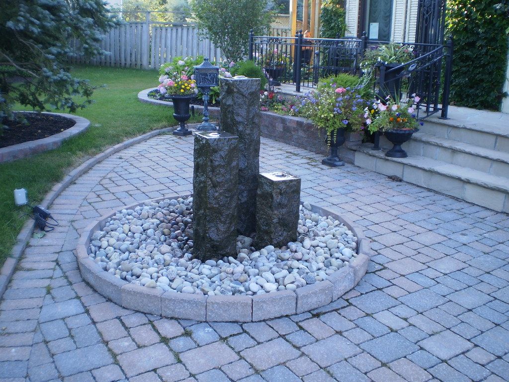 Stone garden centerpiece a conversation piece adding a for Landscaping rocks east bay