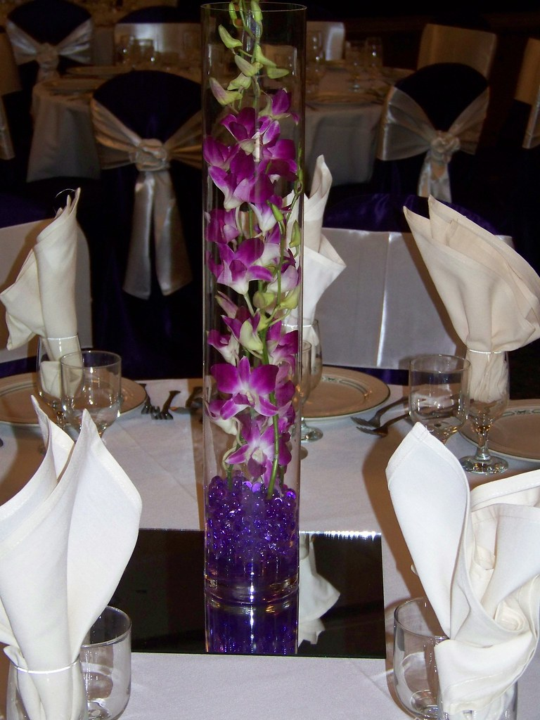 Purple dendrobium orchids centerpiece with gel bead