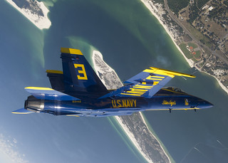 Blue Angels pilot performs a looping maneuver over Naval Air Station Pensacola during a practice flight | by Official U.S. Navy Imagery