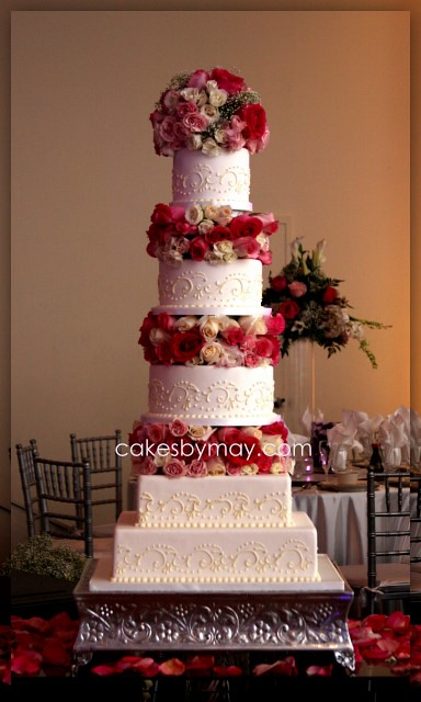 wedding cakes with flowers in between the tiers 5 tier wedding cake with fresh flowers freehand scrolls 26021