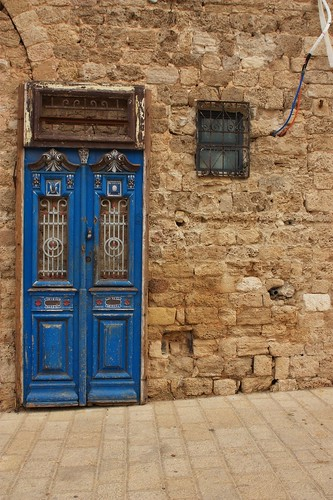 Old wooden door and a window located in Jaffa, Israel | by Phish Photography