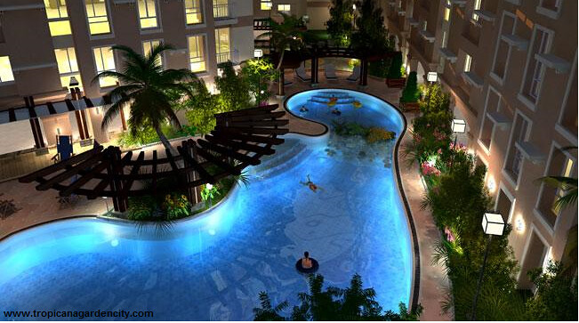 Amenities swimming pool nigth scene tropicana garden for Garden city pool 11530
