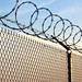 razor wire on fence (you are not welcome here_