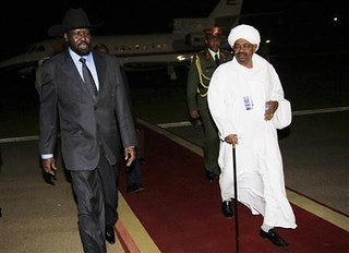 Silva Kir, the leader of south Sudan and President Omar al-Bashir of Sudan. The President said he would recognize the south if it voted for separation from the central government. Factional fighting in the south may jeopardize their independence. | by Pan-African News Wire File Photos