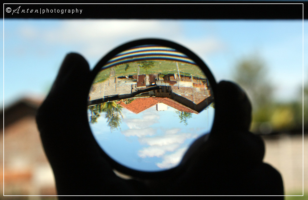 Upside down house thru magnifying glass | Upside down