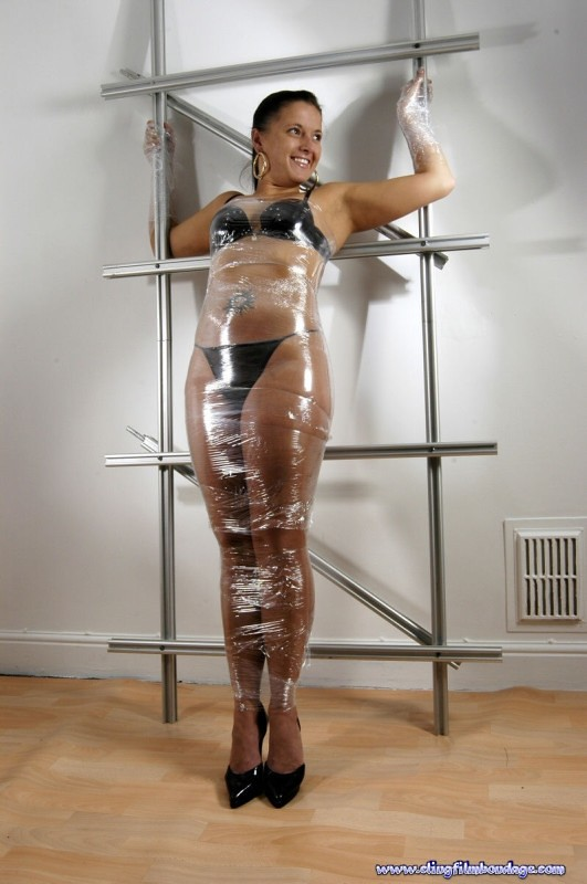 Duct tape mummified girl stands hops - 1 1