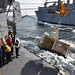 USS Shiloh Sailors receive cargo from USNS Matthew Perry.
