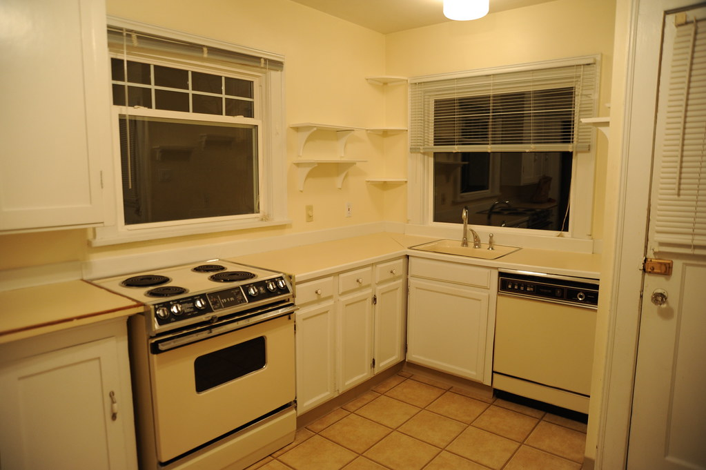 Rental house kitchen, yellow walls, yellow fixtures and ap ...