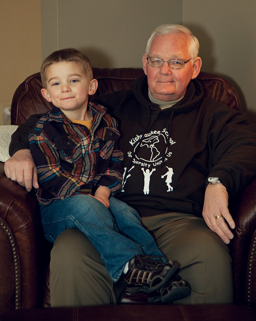 Young boy sitting on his Grandpa's lap