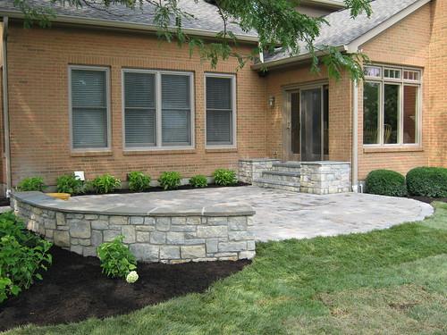 limestone sitting wall with bluestone cap and paver patio