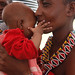 Maasai woman holds an infant
