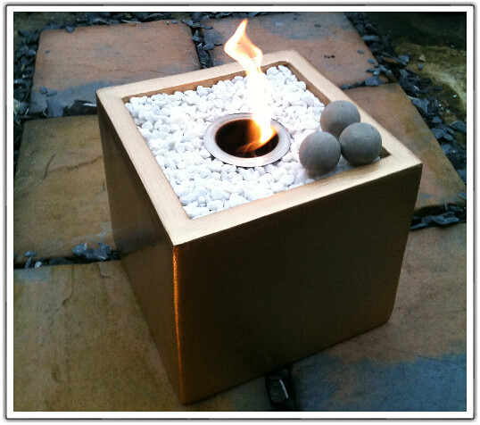 Gold deluxe fire bowl cube with concrete fire spheres