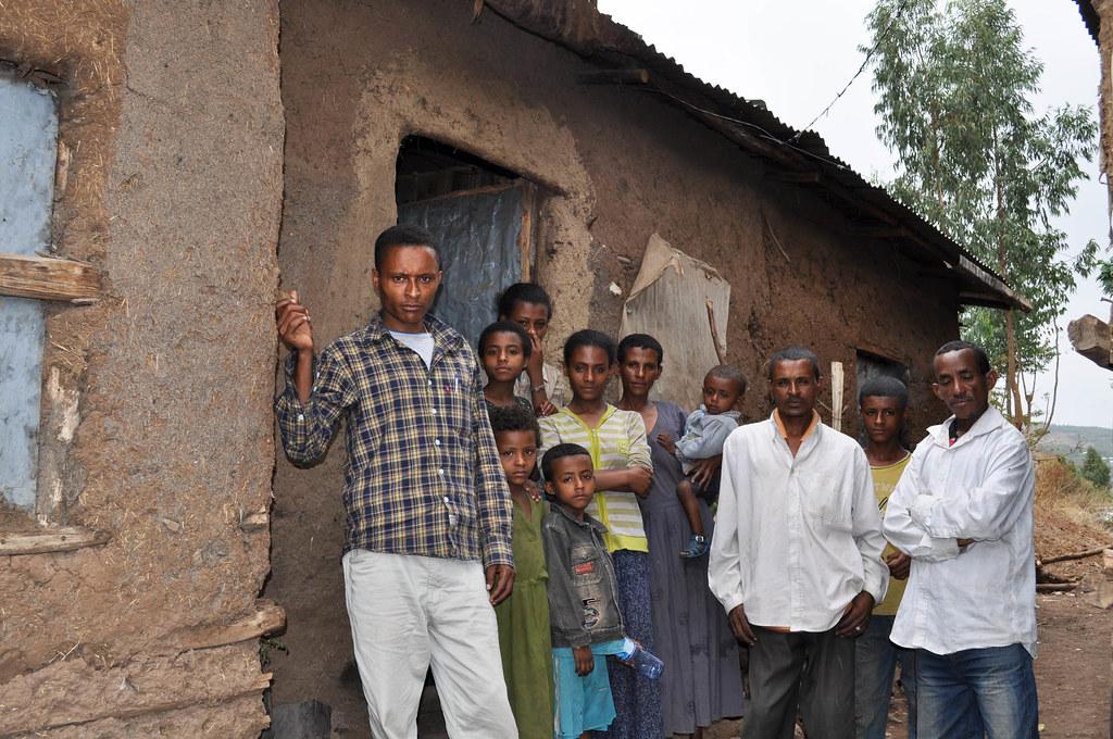 Ethiopian family outside their home