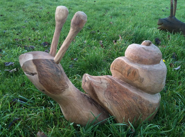 Oak snail chainsaw carving flickr photo sharing