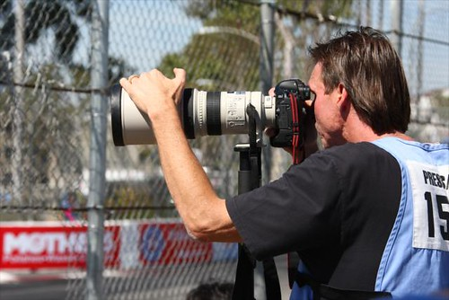 MLB Legend Randy Johnson shooting some photos of the on-track action | by IndyCar Series
