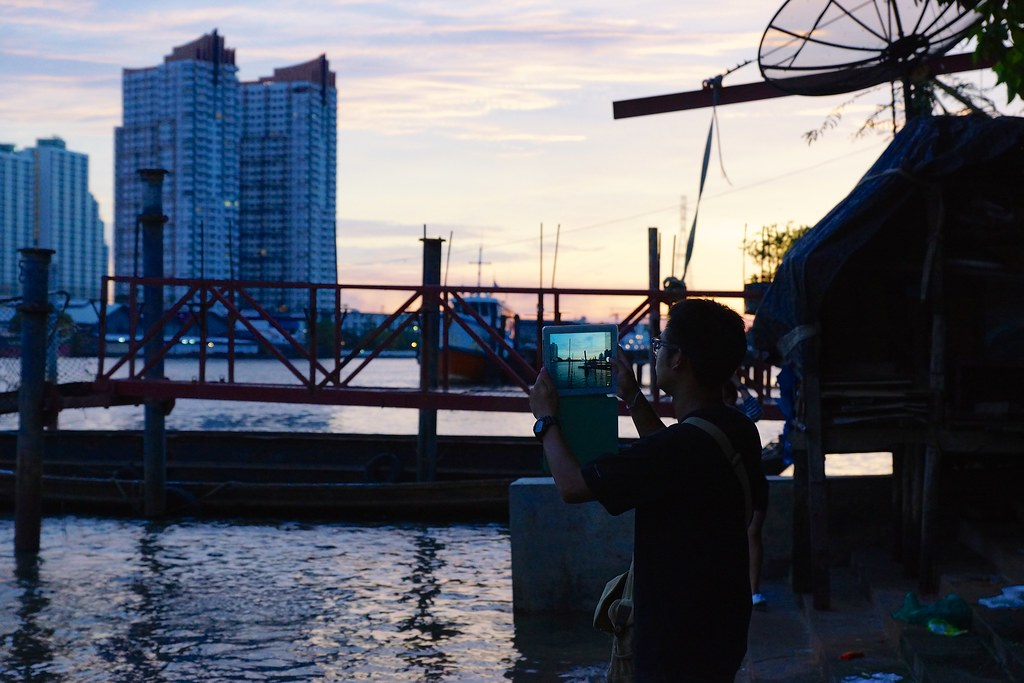 iPad photography by the Chao Phraya river in the evening, Bangkok, Thailand