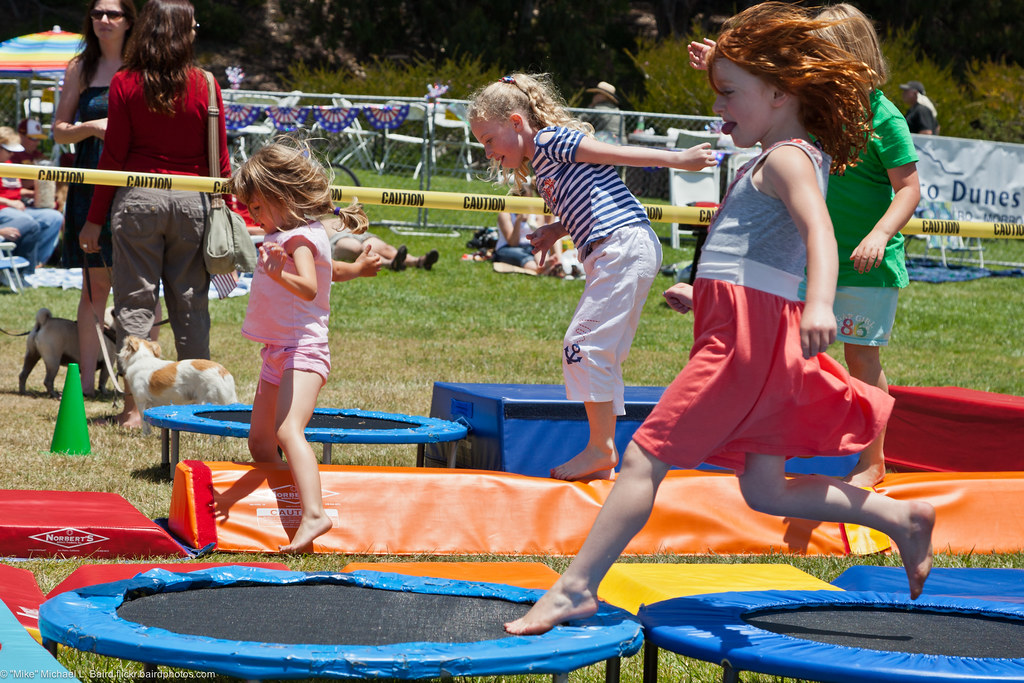 Kids On Trampolines People At Morro Bay Ca Fourth Of Jul