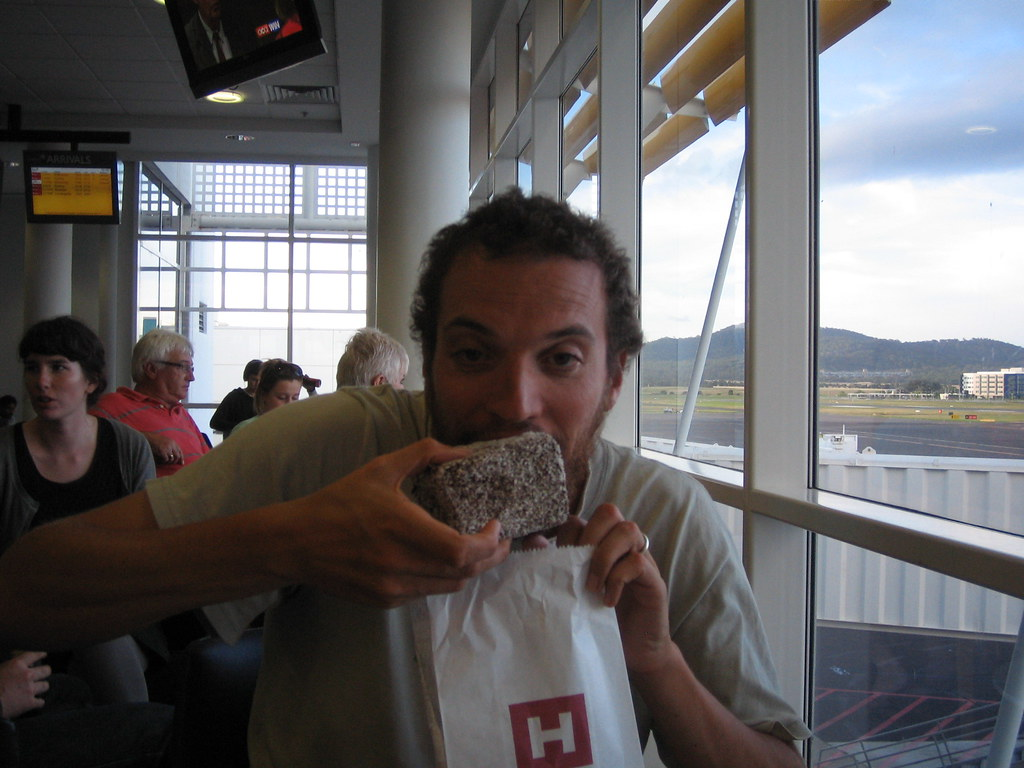 Me and the giant lamington. And yes, I am about as drunk as I look in this photo.