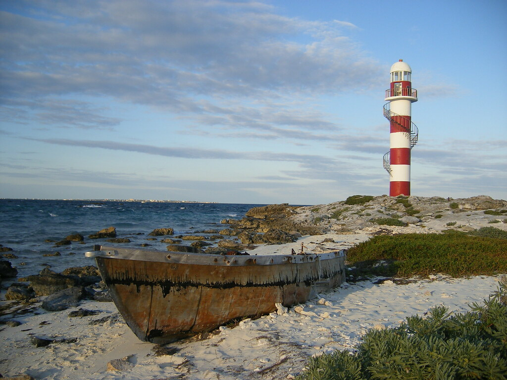 Lighthouse And Old Boat In Cancun Mike Whaling Flickr