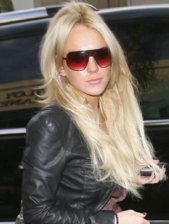 Lindsay Lohan and Ray Ban 3211  35b2413175