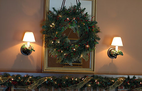 Christmas wreath hung over mirror above fireplace | Mantel ...