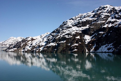 Reflected mountains of Glacier Bay | by runintherain
