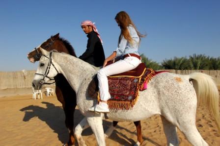 Abu Dhabi Desert Safari - ABET Guest takes a Arabian Horse ...