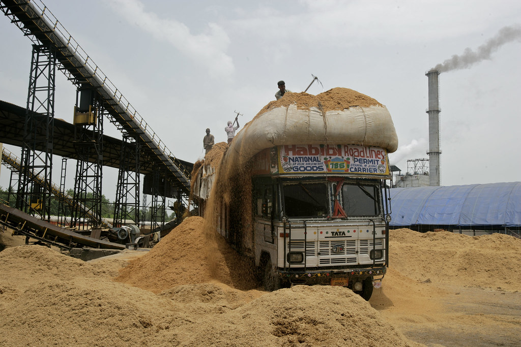 White Land Rover >> Biomass Power Station at Paper Mill | Men unload rice ...