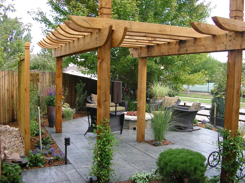 Out door room a pergola over stamped concrete compliment a flickr - Pergola klimplant ...