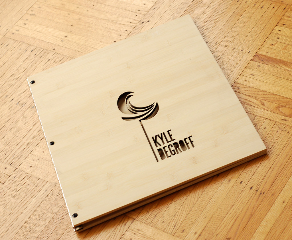Die Cut Book Cover Design : Custom graphic designer portfolio book in bamboo with logo