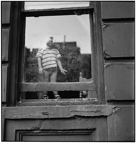 Boy in window, New York, by Eliott Erwitt | by Photo Tractatus