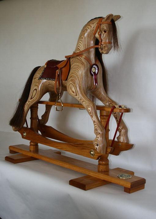 "rocking horse winner essays ""the rocking horse winner"" presents a middles class family whose parents are consumed by materialism, the consequences of which affect the children, especially."