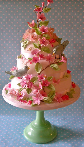 Pastel bird and blossom wedding cake | by nice icing