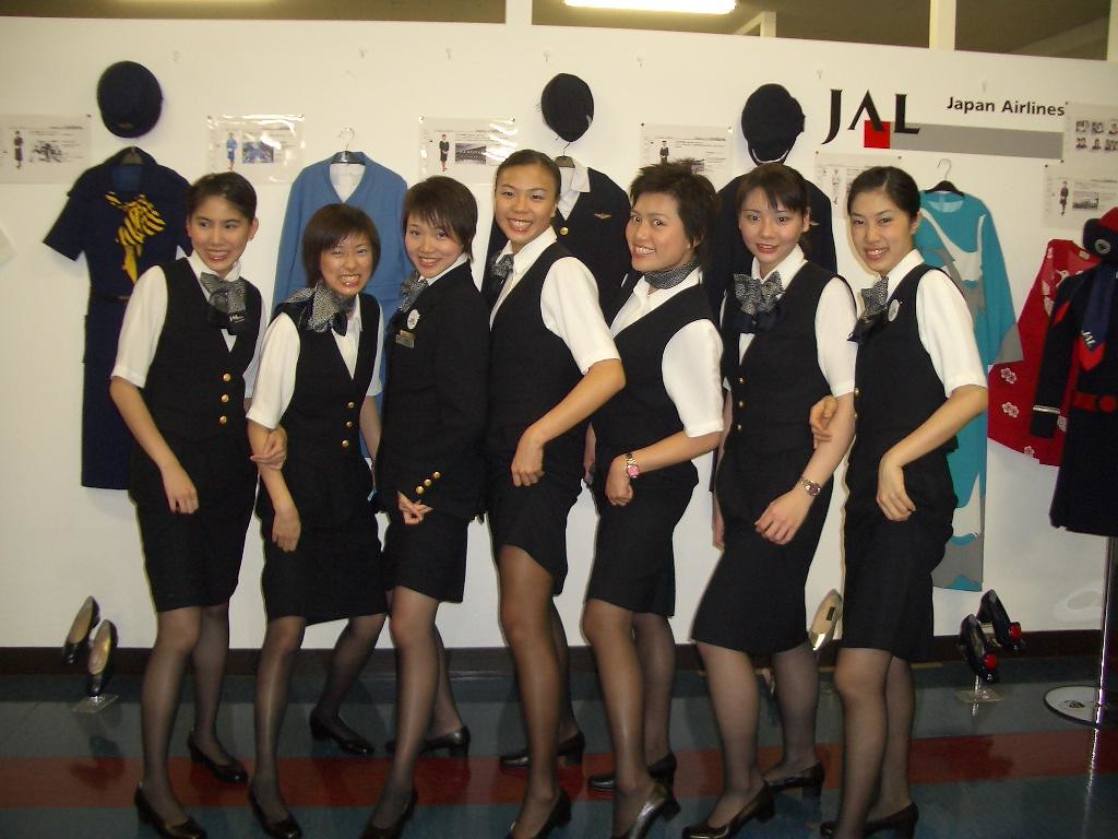 Three japanese airline stewardess kissing 5