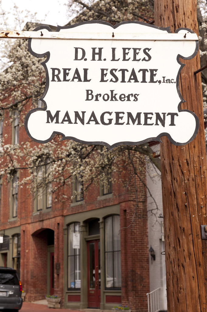 Ral Estate Brokers : D h lees real estate brokers a fancy old sign in