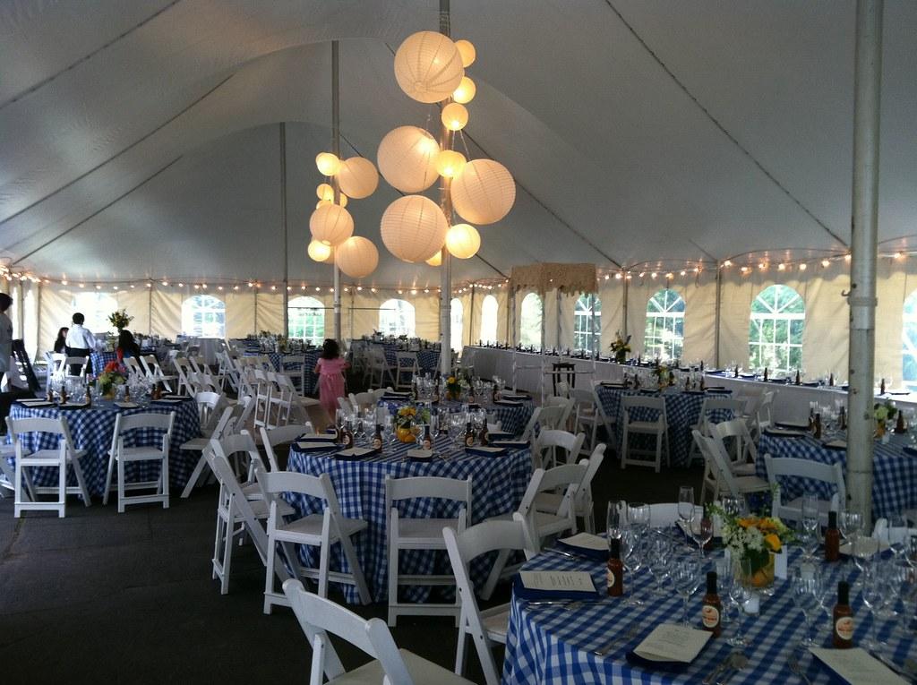 Spring wedding high peak pole tent blue white gingham