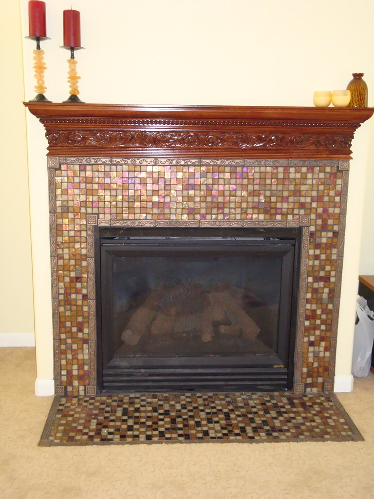 glass mosaic tile fireplace surround and wood mantel flickr