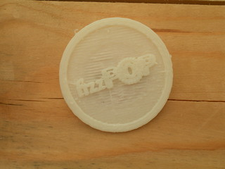 Rob Hunt's fizzPOP badge printed on the MakerBot 3d printer | by Sarah Mount