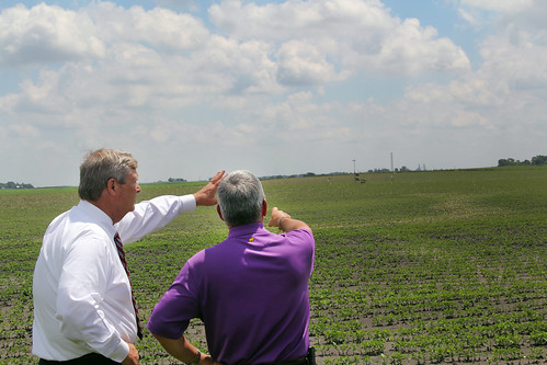 Agriculture Secretary Tom Vilsack listening to U.S. Department of Agriculture (USDA) Agricultural Research Service (ARS) supervisory plant physiologist Dr. Jerry Hatfield explain the equipment to gather information on climate changes and impacts on corn and soybean plants in Iowa