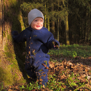 A little man stands in the forest | by Batikart