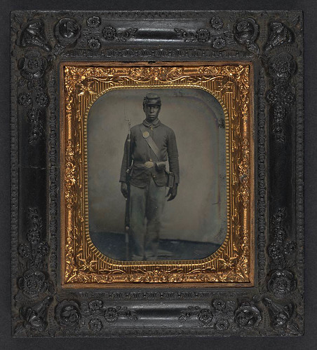 [Unidentified African American soldier in Union uniform with bayoneted musket, cap box, and cartridge box] (LOC) | by The Library of Congress