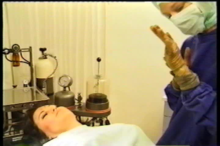 The Doctor putting shower cap on Schiender's head | O R