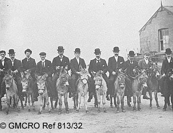 A row of men sitting on donkeys at Blackpool, n.d. (GB124.DPA/813/32).