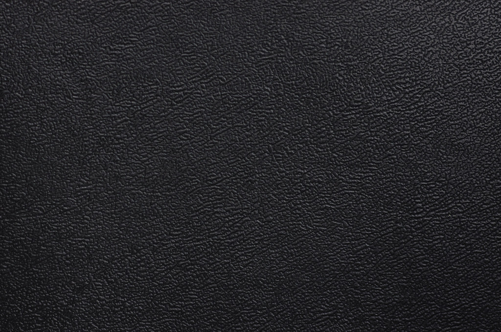 close up of black fake leather texture close up of a black flickr. Black Bedroom Furniture Sets. Home Design Ideas