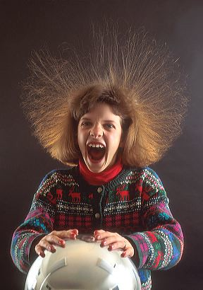 Girl with hair standing on end because of static electrici…   Flickr