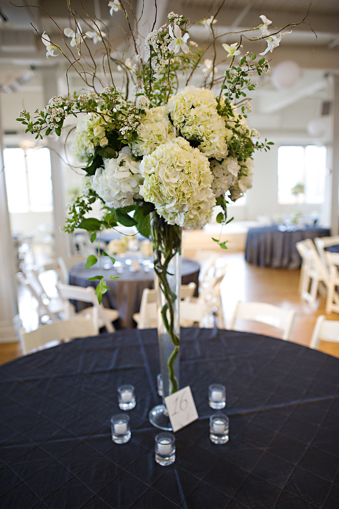 Tall centerpiece with hydrangea and curly willow branches