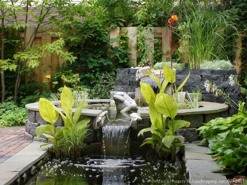 A balinese inspired water feature for Balinese garden design