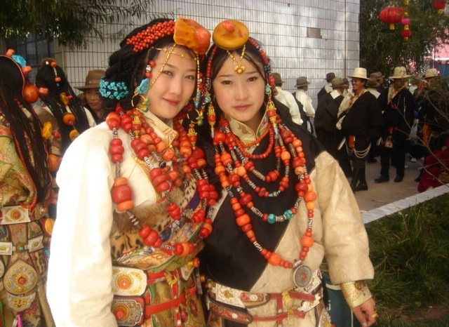 qamdo women Young people perform the ralpa dance in qamdo prefecture in the tibet  their  costumes with knives, while the women wore elaborate jewelry.